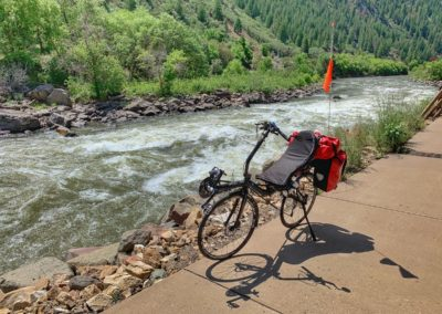 Recumbent bike next to the river in Colorado